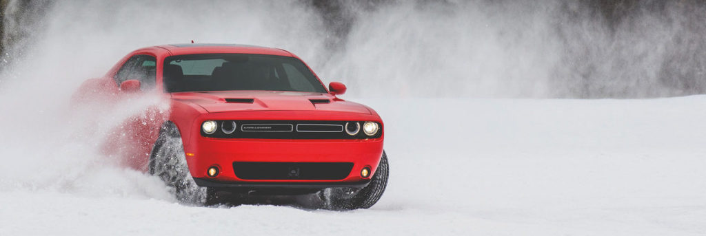2019 Dodge Challenger driving through the snow