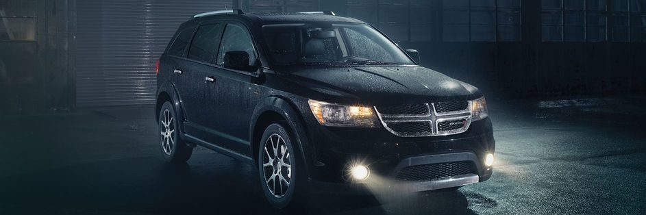 Dodge Journey in a black rain shroud