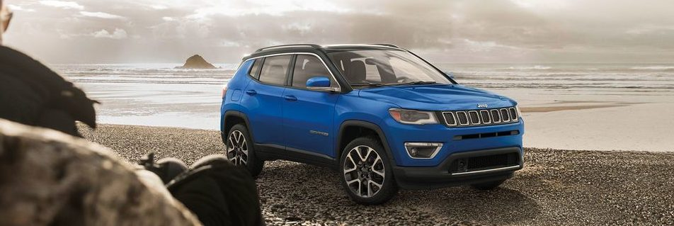 Jeep Compass parked on rocks