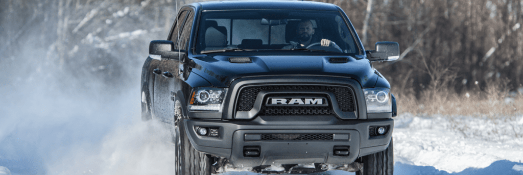 Front on view of Ram 1500 driving in the snow