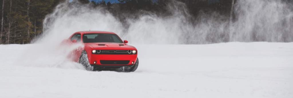 Challenger driving in the winter snow