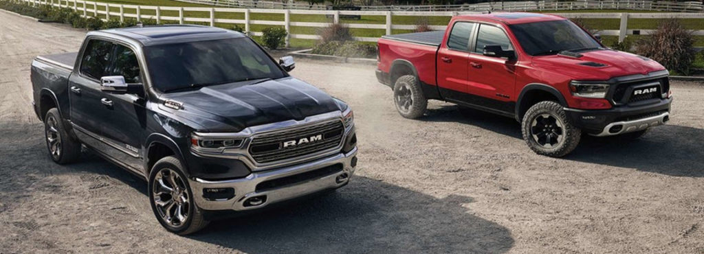 Two 2019 RAM 1500s in black and red