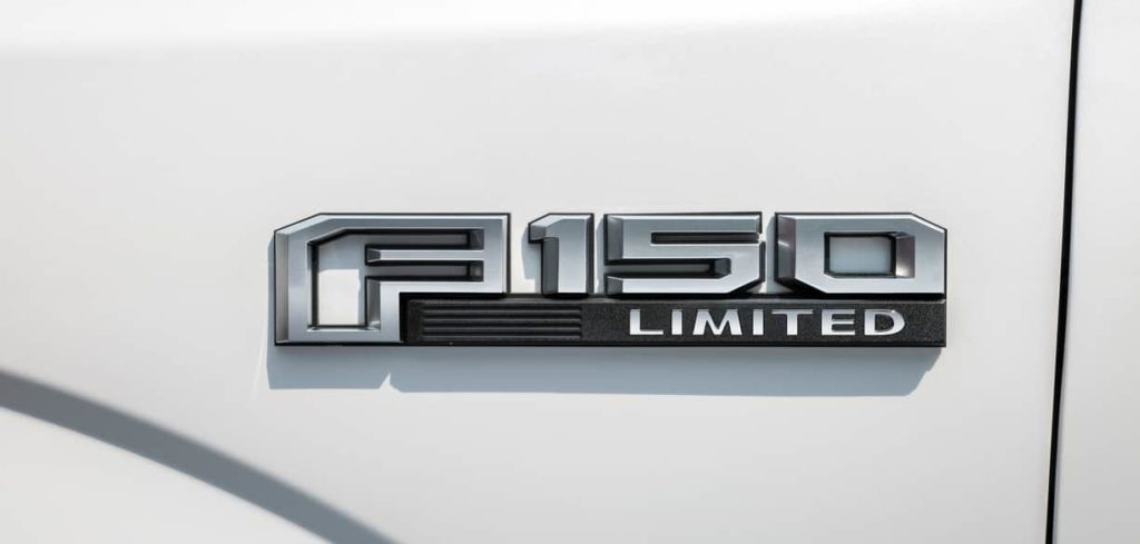 Silver 2019 F-150 Limited badge on white surface