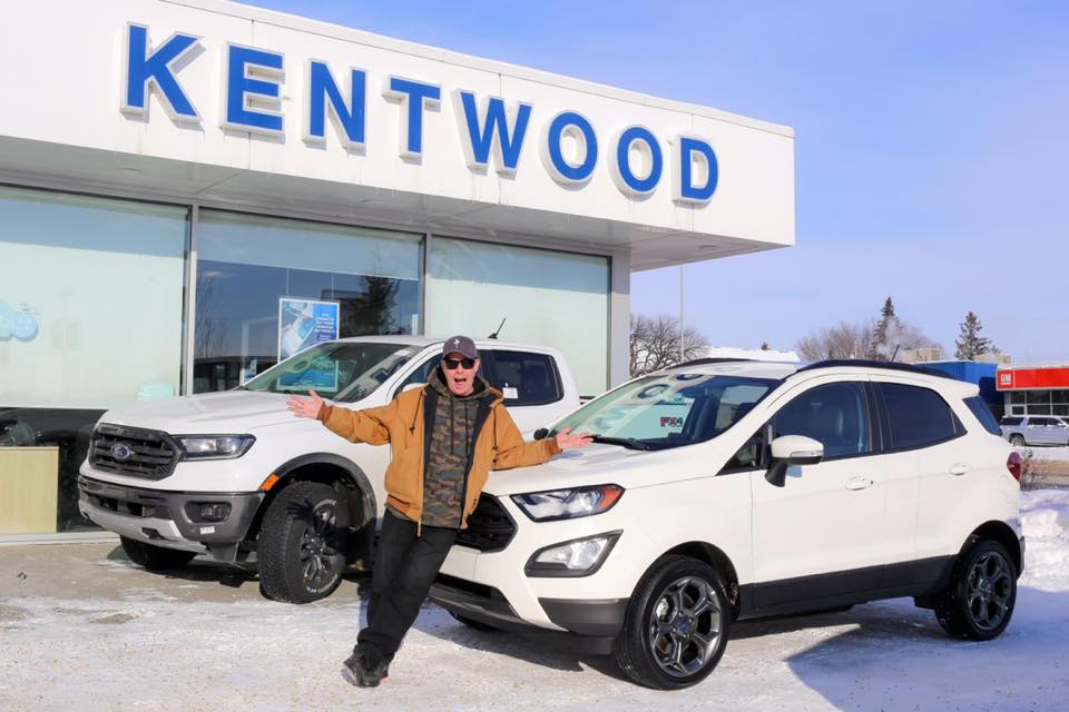 Pete Potipcoe at Kentwood Ford posing in front of the Ford EcoSport SE