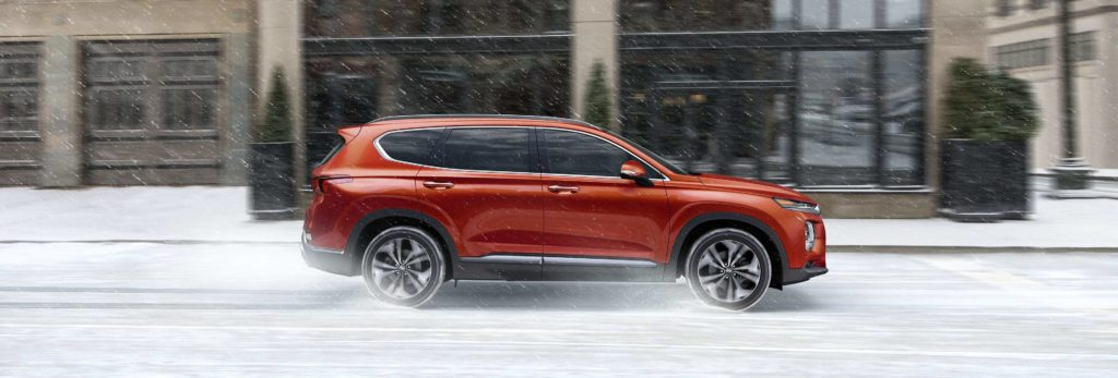 hyundai santa fe driving through snow