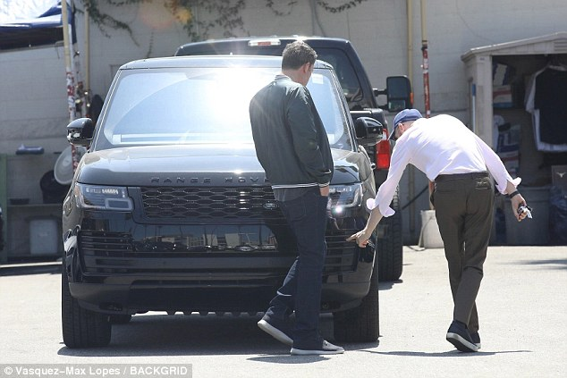 Ben Affleck can't stop smiling as he checks out brand new luxury car on his 46th birthday