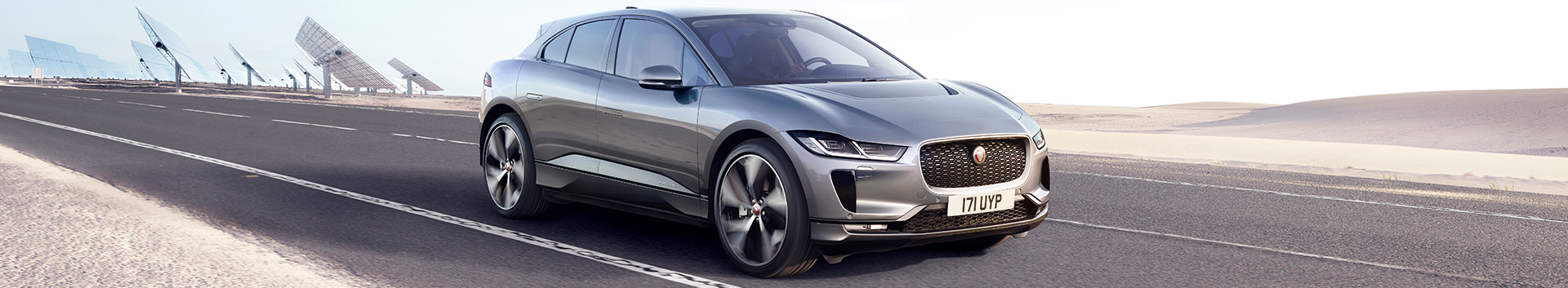 Front 3/4 exterior view of the Jaguar 2021 I-Pace driving through the desert highway