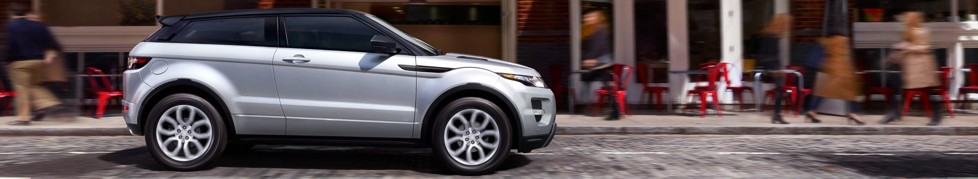Land Rover - Vehicle on Street by Cafe