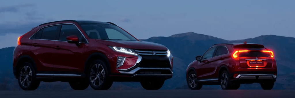 Two Mitsubishi Eclipse Cross vehicles at night