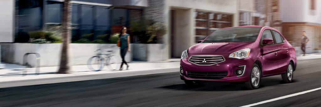2019 Mitsubishi Mirage G4 driving down a city street with a blur effect