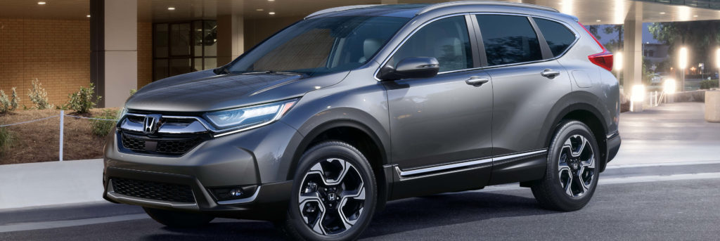 2019 Honda CR-V parked outside of a large building with glass windows