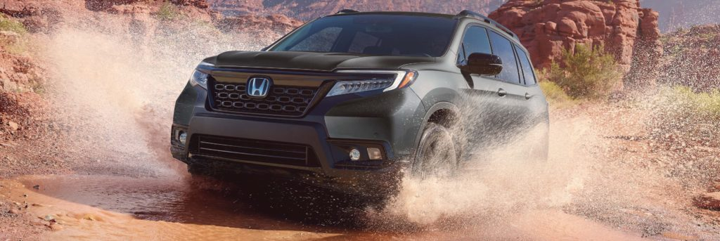 2020 Honda Passport driving with dust coming up from its tires