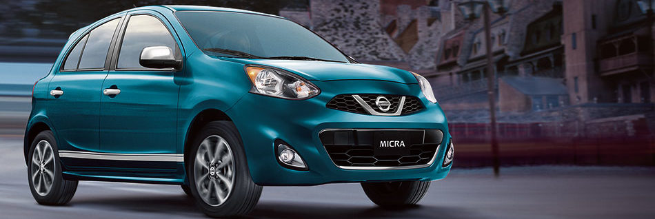 2019 Nissan Micra with a chrome grille in front of classical old buildings