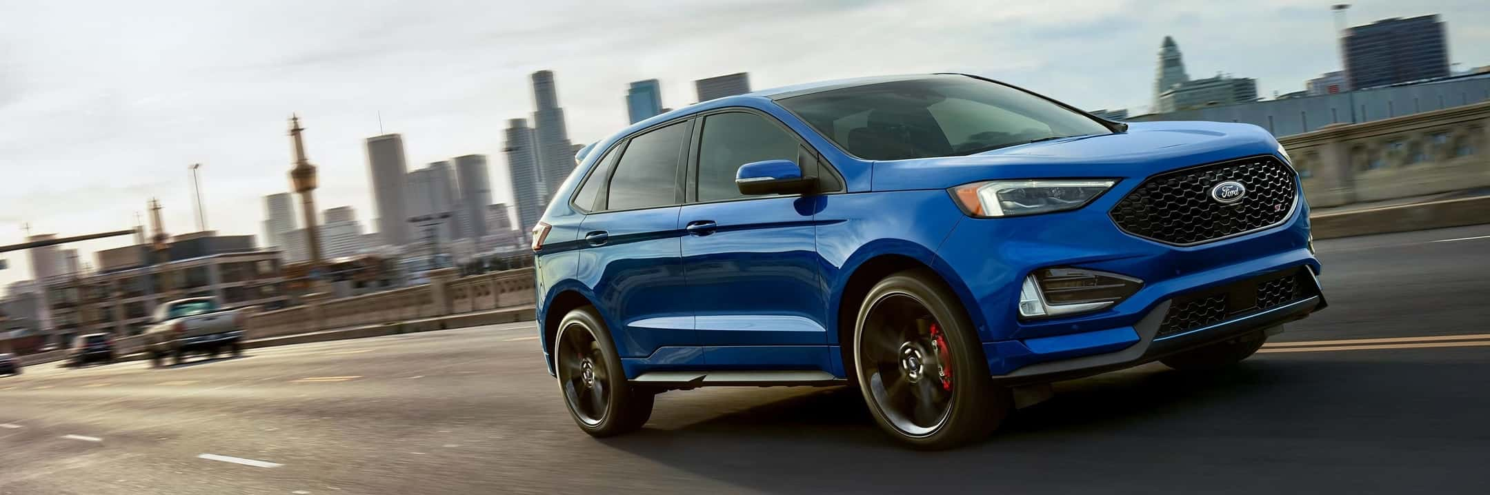 2019 Ford Edge ST driving in a street
