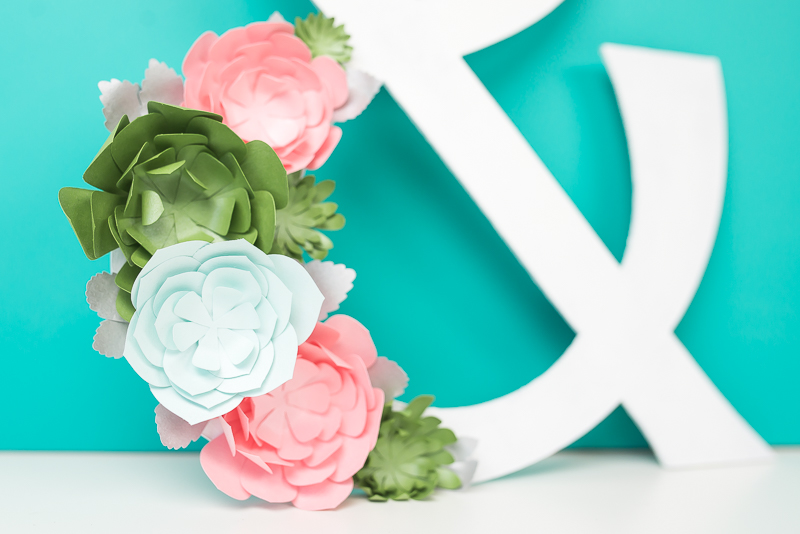 Get step-by-step instructions for making paper succulents using your Cricut. Perfect for nurseries, spring decor, and bridal and baby shower decorations!