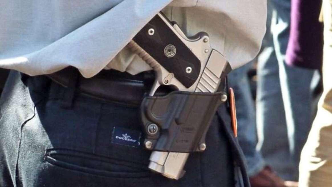 unconcealed-handgun-Michael-Tefft-Flickr