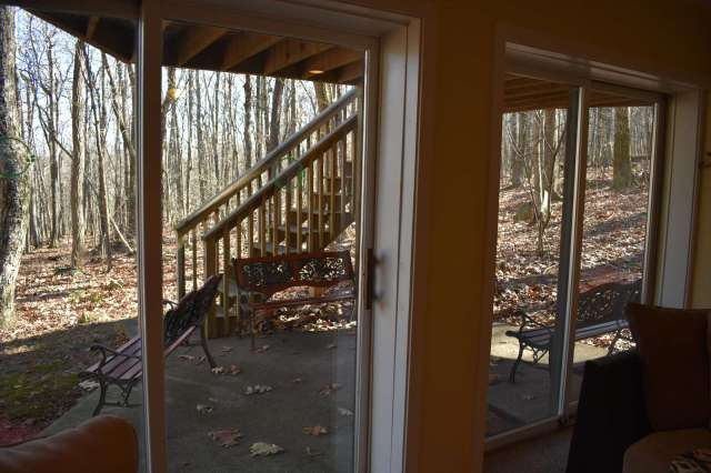 Sliding glass door Family Room - 2 sets of sliding glass doors with several wildlife viewing benches on patio