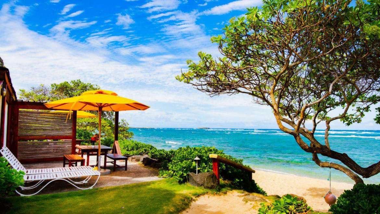 Patio of Ocean Sun directly on beachfront.