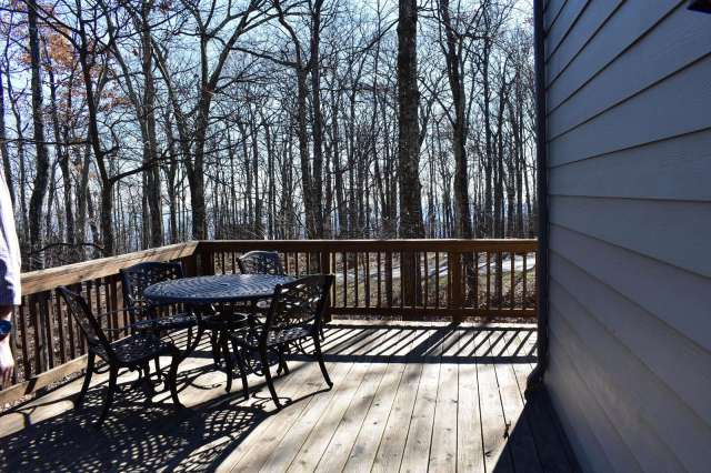 The table and chairs in corner or large wrap around deck
