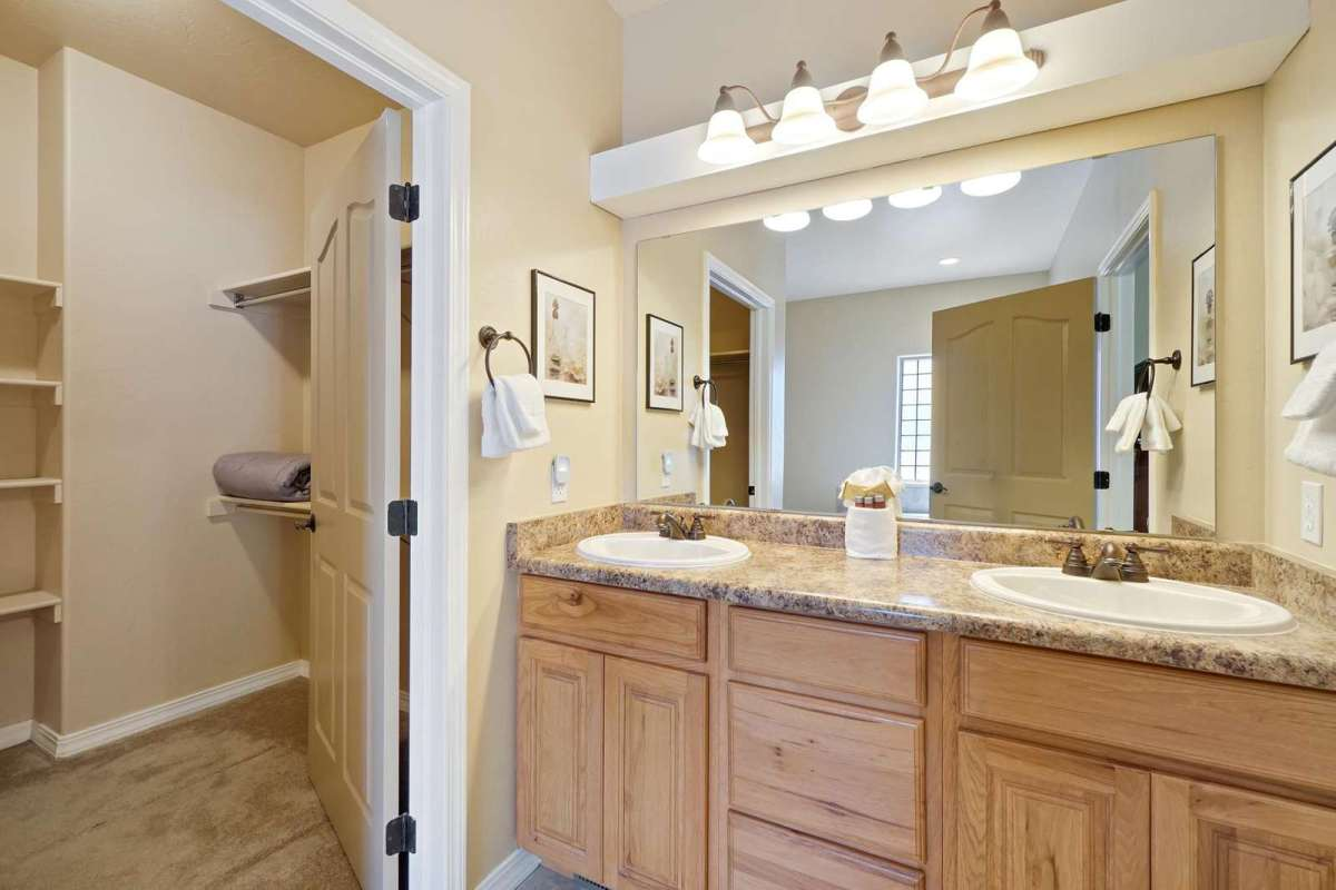 Bright and spacious master bathroom has double sinks with lots of space