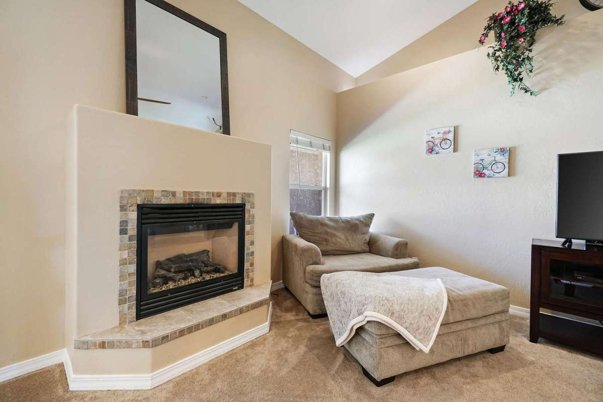 Oversize couch with ottoman, natural gas fireplace