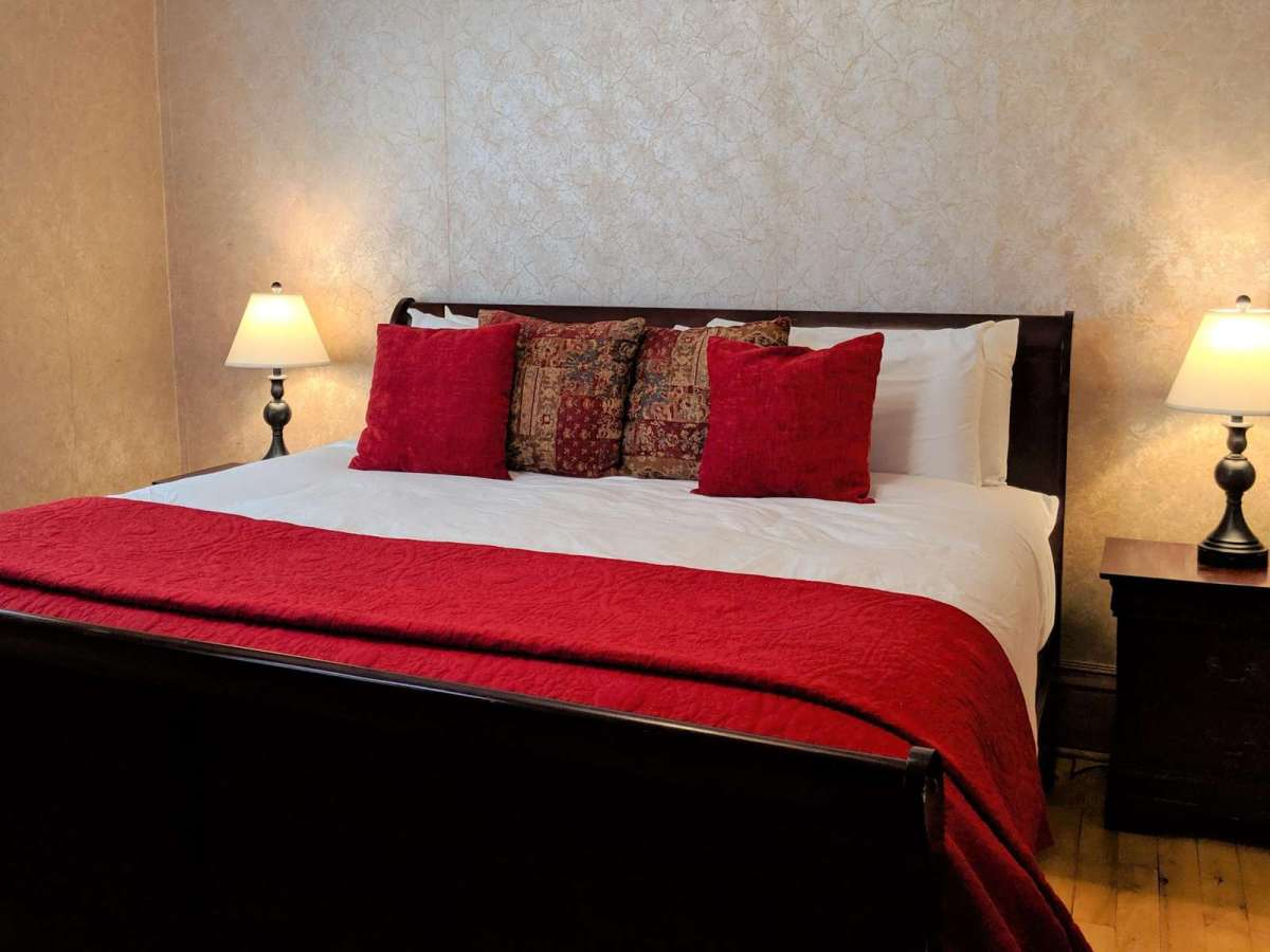 King Size Bed Located on the Main Level