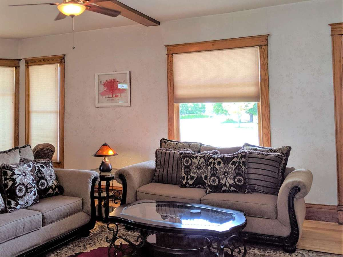 Lots of windows wrap around this bright living room