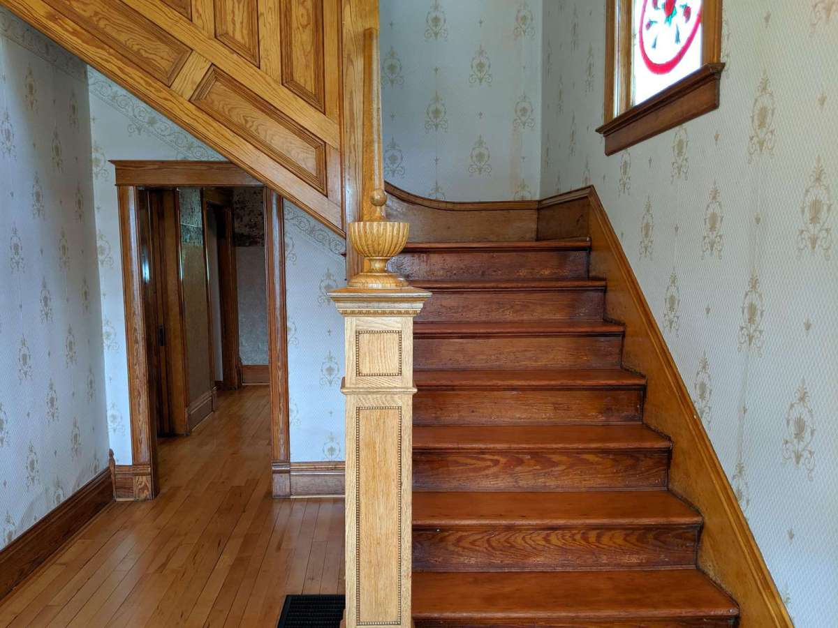 Gorgeous Foyer with original wood staircase