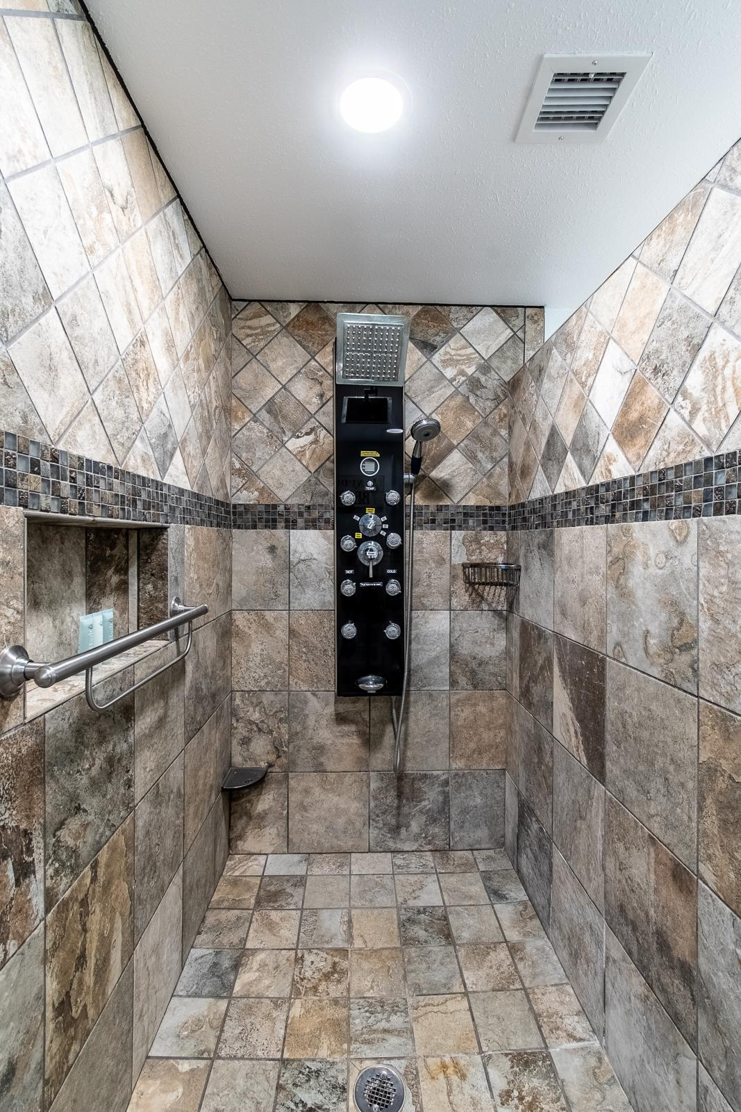 The private master bath has a walk-in shower