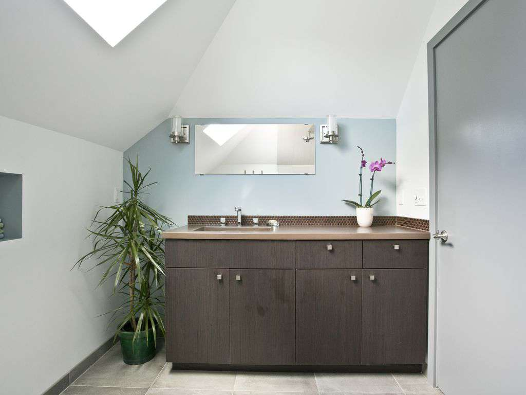 Full large bathroom on the second floor with walk in tiled shower.