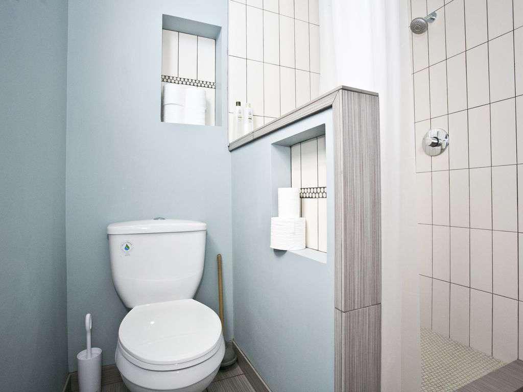 Beautiful bathroom with tiled shower on the main floor.