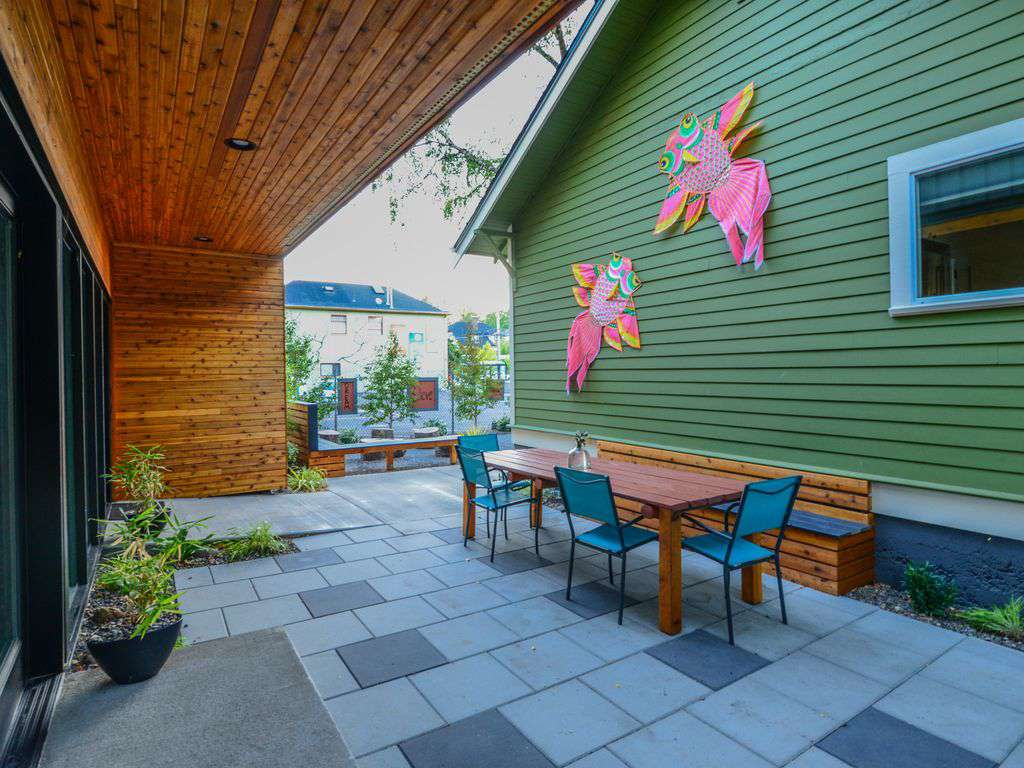 Outdoor seating at the table, benches & porch. Plus 4 square and darts to play while you BBQ..