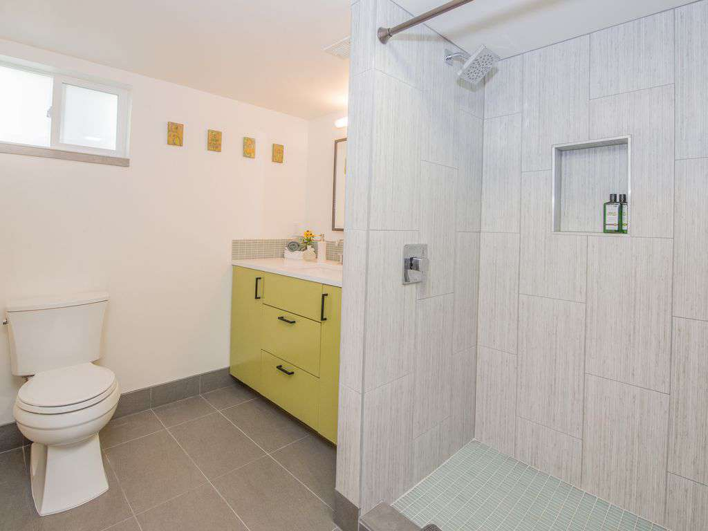 The 2nd full bath is in the lower level, with walk in shower and beautiful tile.
