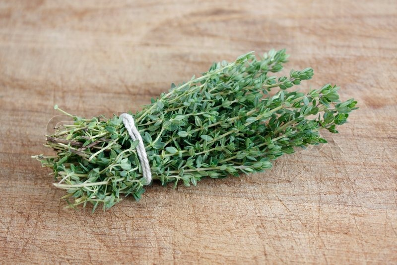 Sprig of thyme on wooden background | Stock image | Colourbox
