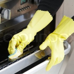 Best Kitchen Cleaner Cabinets Cost Per Foot Hands With Yellow Rubber Gloves Cleaning The Oven | Stock ...