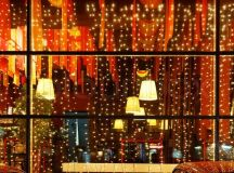 Christmas decorative lights of restaurant window in night ...
