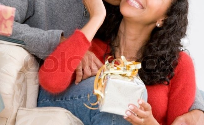 An African American Couples In Love Celebrating Christmas