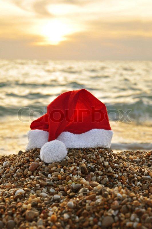 Santa Claus Hat On The Beach Stock Photo Colourbox