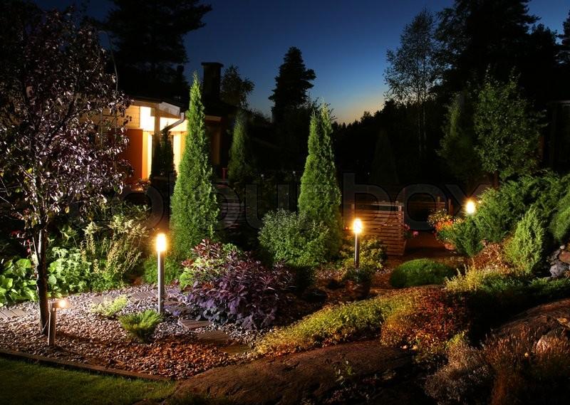 Home garden illumination autumn evening   Stock Photo