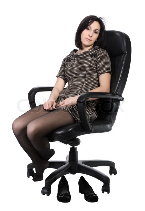 Girl in brown dress sitting in an   Stock Photo