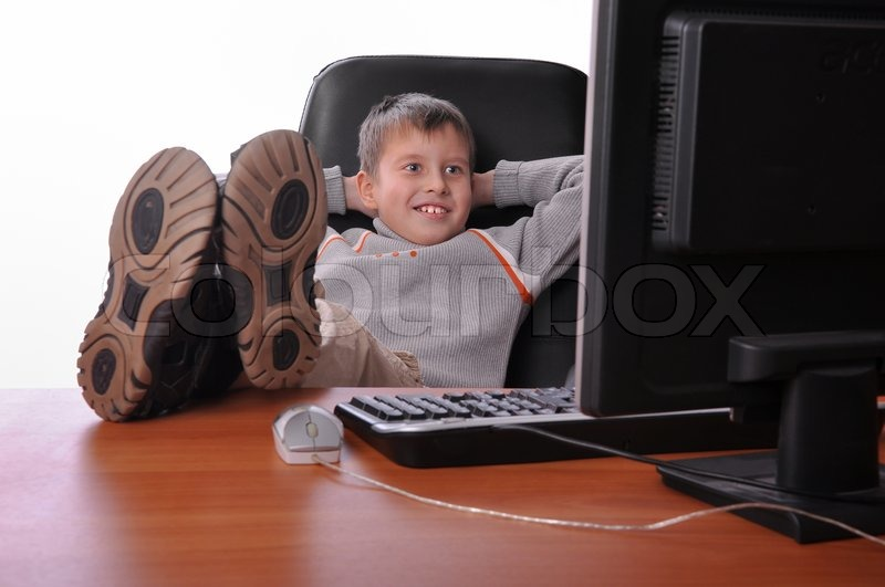 Handsome young boy relaxing at the office with his shoes
