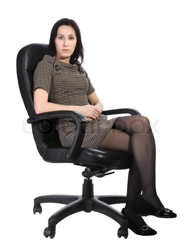 Girl in brown dress sitting in an office chair isolated