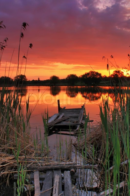 Old Fishing Bridge At Sunset On The River Stock Photo