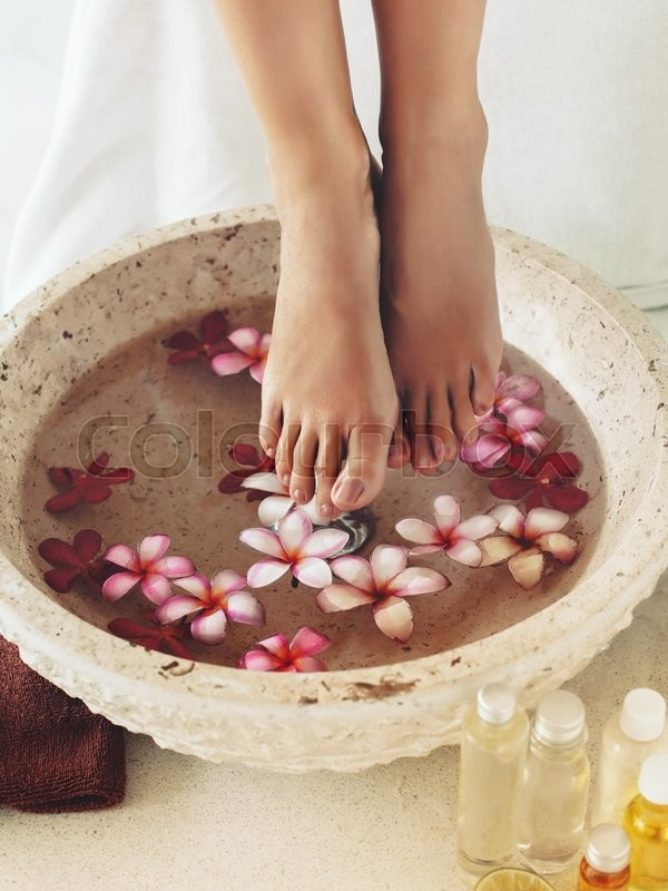 Foot bath in bowl with tropical flowers and oil spa pedicure treatment  Stock Photo  Colourbox