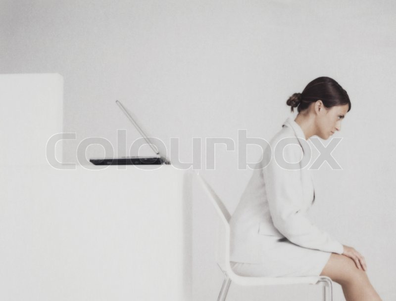 desk chair leans forward high speed lift matthieu spohn altopress maxppp stock photo colourbox image of c woman sitting in