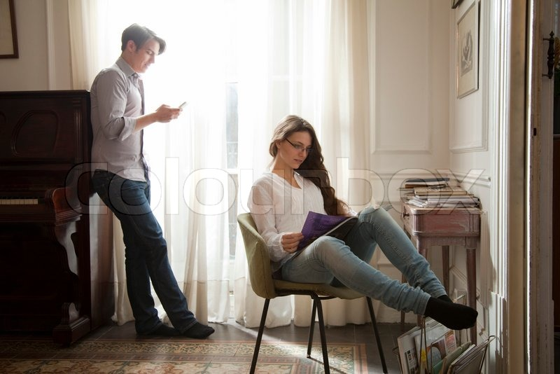 Couple Relaxing In Front Of Fireplace Man Looking At Woman Stock ©sigrid Olsson/altopress/maxppp ; Couple Relaxing At Home