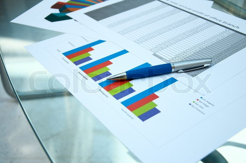 Business documents lay on a glass table   Stock Photo