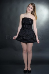 Girl in black dress on dark background | Stock Photo ...