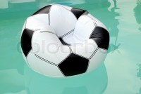 Floating rubber inflatable armchair resembling a soccer ...