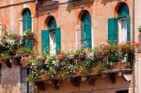 Italian balcony with beauty flowerpots and flowers | Stock ...